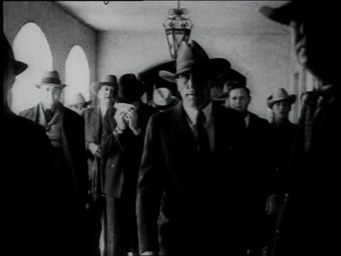 police escorting members of dillinger's gang down a hallway / tuscon, arizona, united states - 1934 stock videos & royalty-free footage