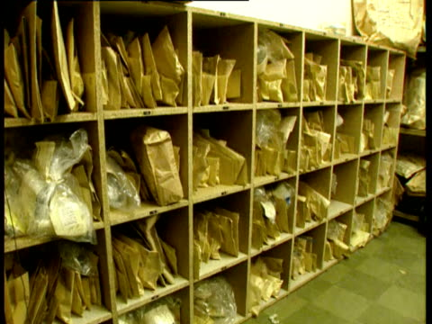 police evidence room containing envelopes & packages of seized drugs / cms brown forensic exhibits envelope / cms plastic bag containing seized... - plastic bag stock videos & royalty-free footage