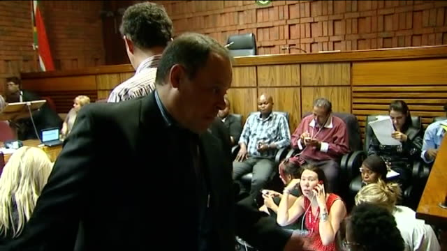 police face inquiry over death of taxi driver 2022013 pretoria int detective hilton botha talking with othersin court during oscar pistorius bail... - court hearing stock videos and b-roll footage
