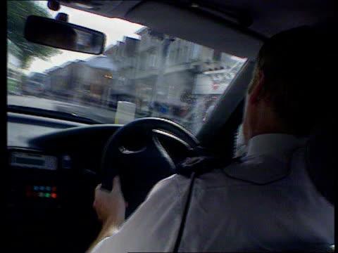 police federation anarchy warning; lib england: kent: ext police car along street with lights flashing and siren sounding int car cbv police officers... - kent england bildbanksvideor och videomaterial från bakom kulisserna