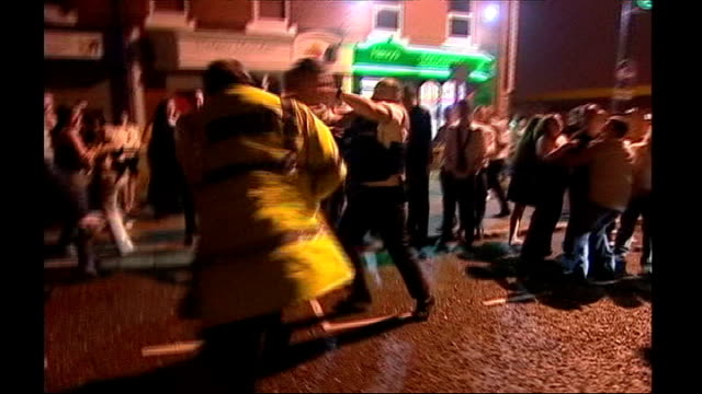 Police federation warns against police budget cuts ENGLAND Various shots of police officers restraining and arresting drunken people fighting outside...