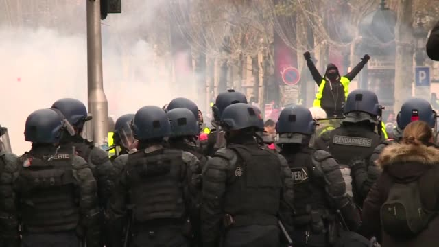 police fire tear gas and water cannons in central paris against yellow vest protesters demanding french president emmanuel macron roll back tax hikes... - water cannon stock videos & royalty-free footage