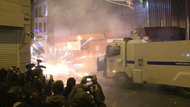 police fire water cannon tear gas and rubber bullets to disperse hundreds of antigovernment demonstrators in both ankara and istanbul who had been... - water cannon stock videos and b-roll footage