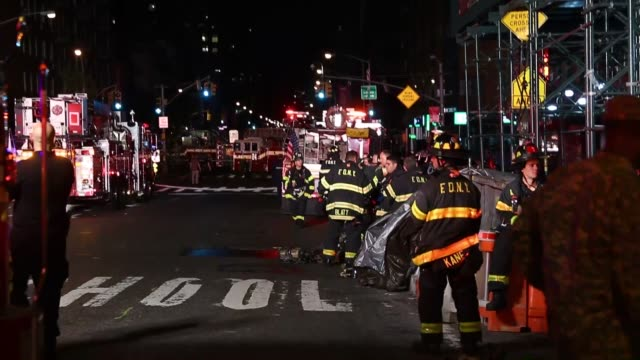 police, firefighters and emergency workers gather at the scene of an explosion in manhattan on september 17, 2016 in new york city. twenty-nine... - 2016 stock videos & royalty-free footage
