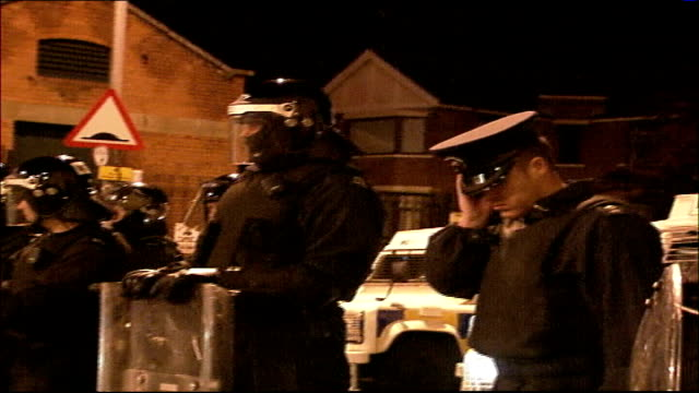 Police foil loyalist violence Police operation NORTHERN IRELAND Belfast EXT Police helicopter with searchlight in the sky / line of police armoured...