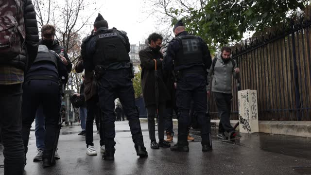 police forces carry out checks and controls of the bags before a demonstration against the 'global security' draft law, on december 12, 2020 in paris... - france stock videos & royalty-free footage