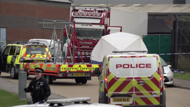 police forensic investigation officers stand near the site where 39 bodies were discovered in the back of a lorry on october 23, 2019 in thurrock,... - articulated lorry stock videos & royalty-free footage
