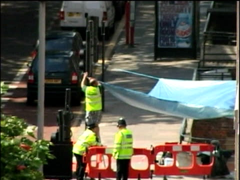 police forensic teams gather evidence from scene of bomb blast on bus tavistock square aftermath of 2005 london bombings; 12 jul 05 - bushaltestelle stock-videos und b-roll-filmmaterial