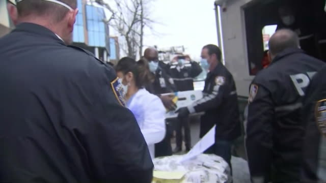 police from the nyc police benevolent association deliver meals to healtcare workers at the jamaica hospital center in queens - healthcare and medicine or illness or food and drink or fitness or exercise or wellbeing stock videos & royalty-free footage