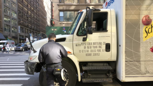 police gives truck parked in new york city street an illegal parking ticket - parking ticket stock videos & royalty-free footage