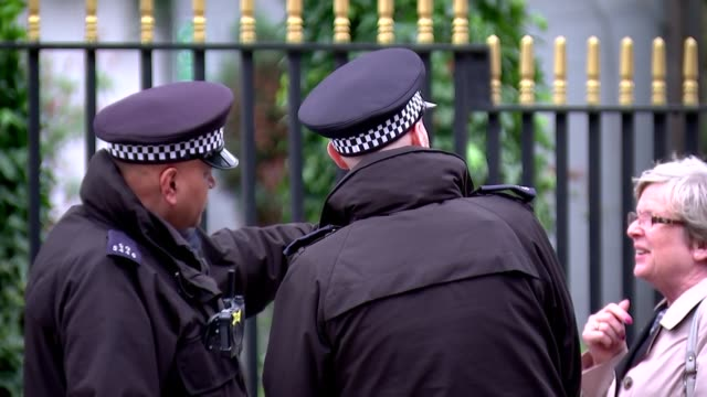 police guard outside london central mosque following new zealand mosque attacks england london regent's park london central mosque ext various shots... - london central mosque stock videos & royalty-free footage