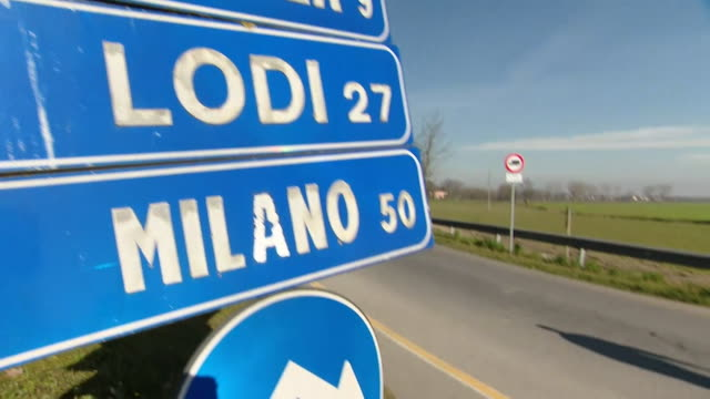 "police guard roadblock as town of codogno in italy is under quarantine due to coronavirus - ""bbc news"" video stock e b–roll"