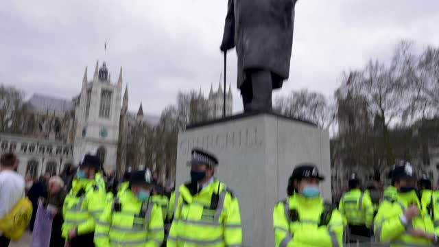 "police guard the winston churchill statue from protesters on march 20, 2021 in london, england. ""world wide rally for freedom"" protests, with... - city life stock videos & royalty-free footage"