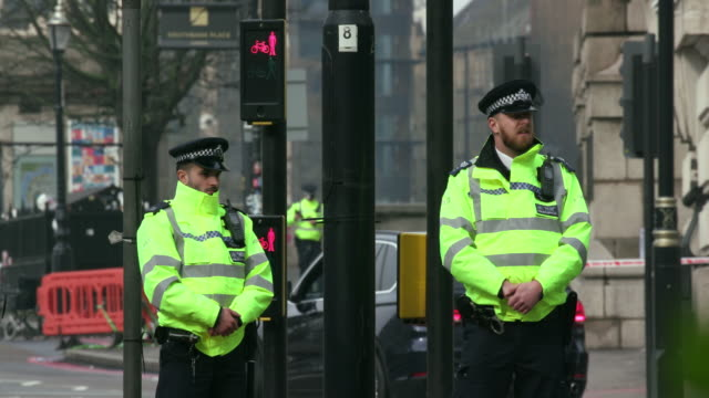 police guard westminster bridge the morning after terror attack; westminster, london - terrorism stock videos & royalty-free footage