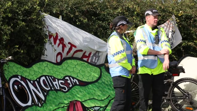 police guarding cuadrilla's fracking site at preston new road, little plumpton, lancashire, uk on july 12 2017. - oil industry stock videos & royalty-free footage