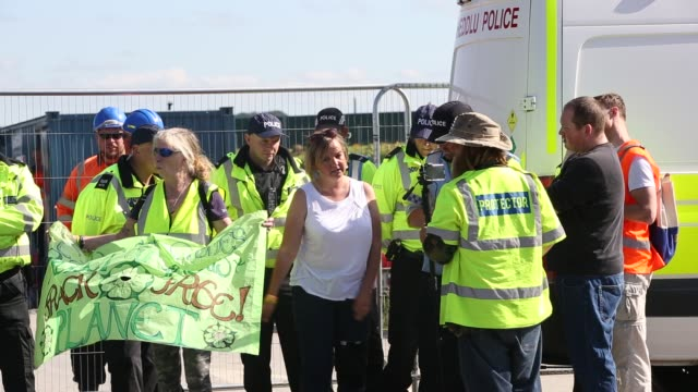 police guarding cuadrilla's fracking site from protestors at preston new road, little plumpton, lancashire, uk on july 12 2017. - oil industry stock videos & royalty-free footage
