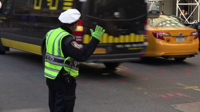 NYPD Police Guiding Traffic in New York City