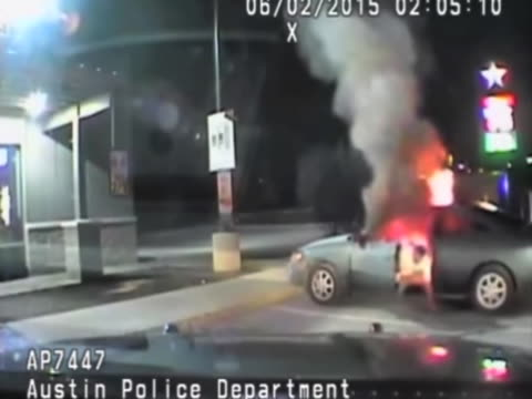 Police have released dashcam footage of a man trying to light himself on fire after being pulled over by cops Police are able to save his life