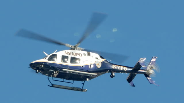 police helicopter doing observation flight. aircraft surveillance monitoring. public safety - helicopter stock videos and b-roll footage