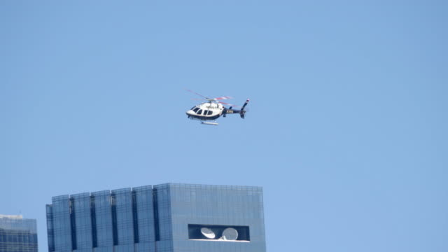 NYPD police helicopter doing observation flight. aircraft surveillance monitoring. public safety