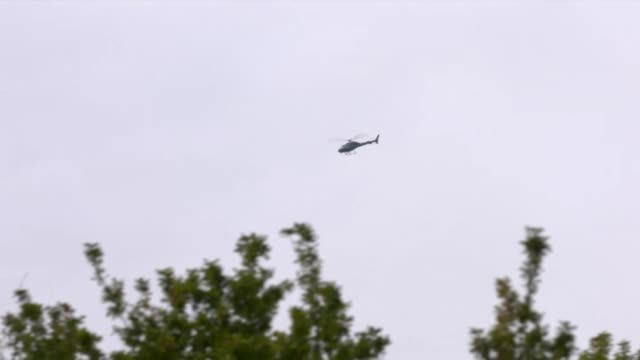A police helicopter flies above Christchurch New Zealand the day after two mosques were attacked by a white supremacist gunman leaving 49 people dead