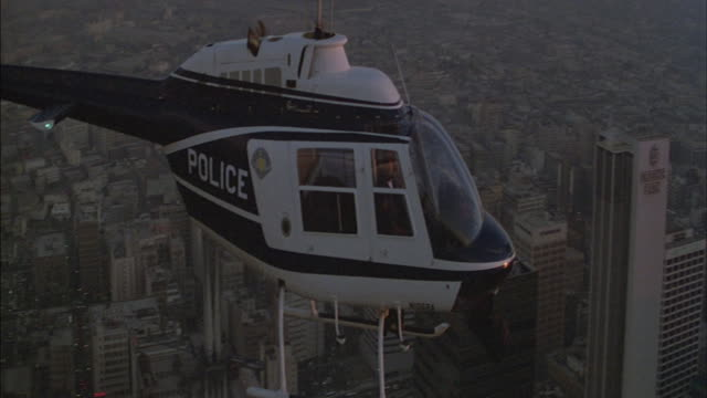 A police helicopter flies above Los Angeles.