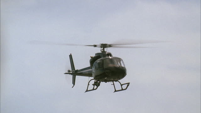 WS POV Police helicopter flying mid air