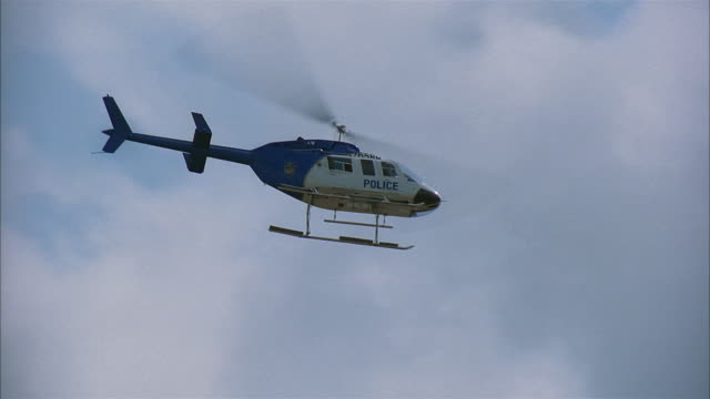 pan police helicopter hovering - hovering stock videos & royalty-free footage
