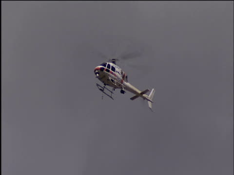 police helicopter hovers in air - helicopter stock videos & royalty-free footage