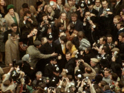 police help paul and linda mccartney fight through the huge crowds following their wedding at marylebone register office 1969 - 1969 stock videos & royalty-free footage