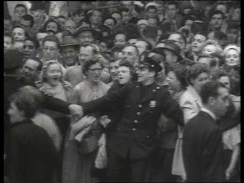 b/w 1954 police hold back crowds at movie premiere / no sound - 1954 stock videos & royalty-free footage