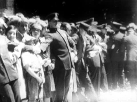 b/w 1927 police holding back crowd on sidewalks in ticker tape parade for lindbergh / newsreel - 1927 stock videos & royalty-free footage