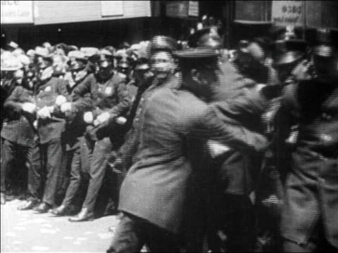 b/w 1927 police holding back excited crowd at parade for charles lindbergh / newsreel - 1927 stock videos & royalty-free footage