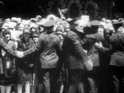 b/w 1927 police holding back excited crowd in parade for charles lindbergh / newsreel - 1927年点の映像素材/bロール