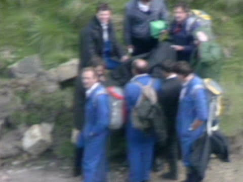 police huddle around ian brady in order to protect his identification during his return to the yorkshire moors to assist police in the search for the... - psychopathy stock videos and b-roll footage