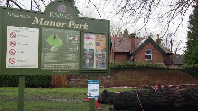 stockvideo's en b-roll-footage met police hunt for killer of baby in aldershot england hampshire aldershot floral tributes close shot message on flowers 'manor park' noticeboard wide... - aldershot
