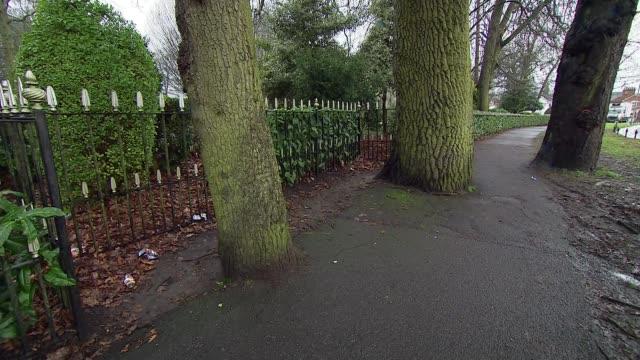 Police hunt for killer of baby in Aldershot ENGLAND Hampshire Aldershot EXT Path in park and entrance gates to park