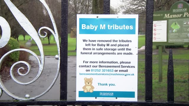 Police hunt for killer of baby in Aldershot Notice on gate stating Baby M tributes have been removed IN floral tribute by tree Messages of condolence...