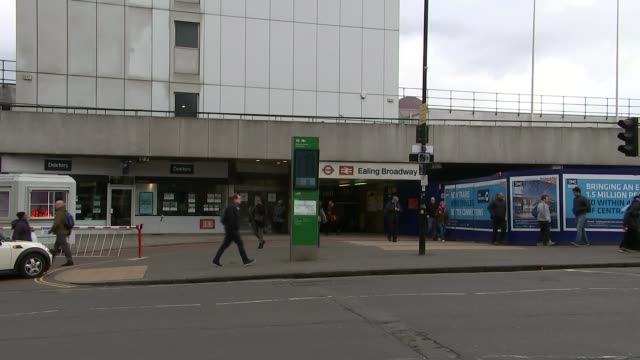 police hunt men over homophobic attack on londonbound train t23021721 / tx ext general view of entrance to ealing broadway station - ホモフォビア点の映像素材/bロール