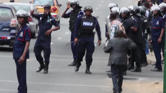 police in ghana on wednesday fired teargas and water cannon on supporters of the main opposition party urging a crackdown on potential voter fraud... - water cannon stock videos and b-roll footage