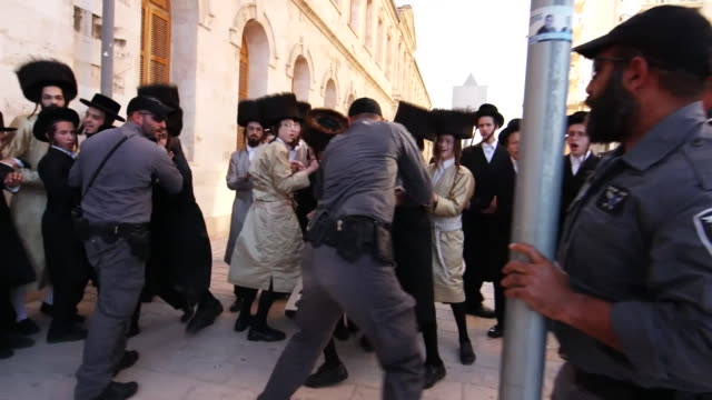 police in jerusalem clashing with protestors demonstrating against the eurovision song contest being held on the sabbath - eurovision song contest stock videos & royalty-free footage