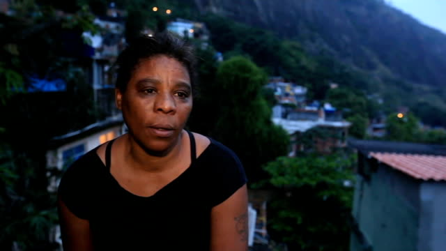 police in operations to clear favelas of drug gangs ahead of 2014 world cup ext sister of amarildo de souza set up shot with reporter / interview sot... - biker gang stock videos & royalty-free footage
