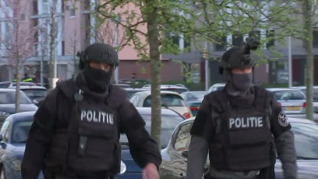 stockvideo's en b-roll-footage met police in protective gear at the site of the utrecht tram shooting in the netherlands on march 18 2019 - (war or terrorism or election or government or illness or news event or speech or politics or politician or conflict or military or extreme weather or business or economy) and not usa