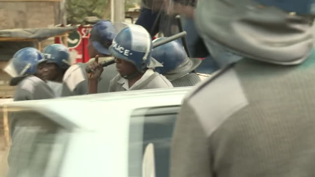Police in riot gear beating antigovernment corruption protesters in Harare Zimbabwe