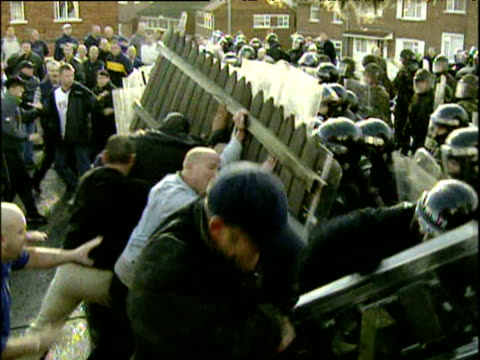Police in riot gear force back crowd of loyalist protesters blocking Catholic children's route to Holy Cross Primary School 3 Sep 01