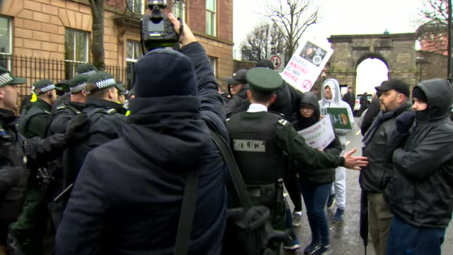 police in scuffles with protesters supporting paul mcintyre charged with murder of journalist lyra mckee outside court in londonderry - crime and murder stock videos & royalty-free footage