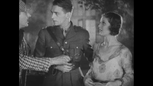 1931 police inspector (eddie kane) dressed as sherlock holmes, questions douglas fairbanks jr and loretta young about some stolen jewels - 1931 stock videos & royalty-free footage