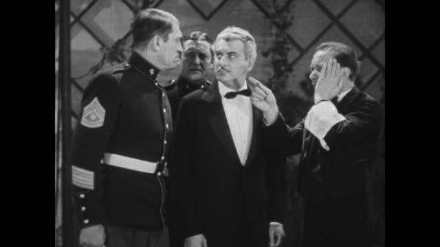 1931 police inspector (eddie kane) questions man on whereabouts during jewel theft before he strikes out, accidentally hitting waiter (el brendel) - 1931 stock videos & royalty-free footage