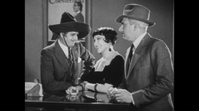 1931 police inspector (eddie kane) tries to question cigarette salesgirl (fifi d'orsay) who is flirting with flamboyant man (warner baxter) - 1931 stock videos & royalty-free footage