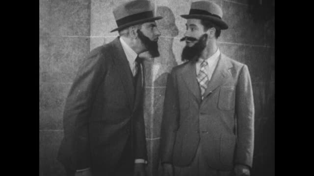 1931 Police inspector (Eddie Kane) wearing fake beard makes tricky man (Joe E. Brown) remove his fake beard before questioning